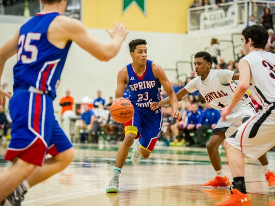 Spring Grove's Eli Brooks (23) drives through the Central York defense during the YAIAA boys basketball championship game at York College on Saturday, Feb. 13, 2016. Spring Grove won 42-36.