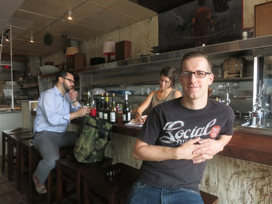 Chef-owner James Rigato pauses at the bar of his new