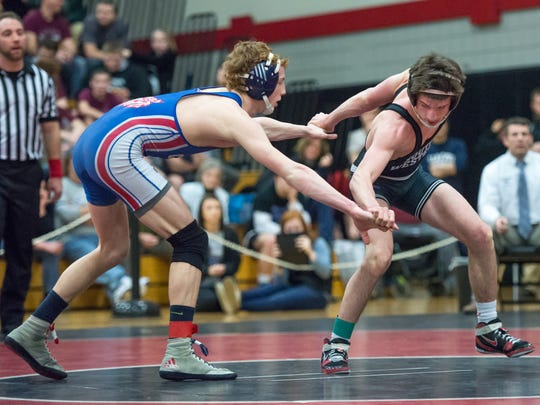 Dallastown's Dalton Daugherty, left, and South Western's Chase Mowery work for position in a 120-pound bout during the semifinal round of the District 3 Class AAA Section V wrestling tournament at South Western High School on Saturday, Feb. 20, 2016.