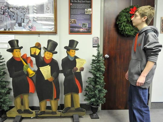 Ethan Horn checks out the area dedicated to the Glen Rock Carolers, during his visit to the Glen Rock Museum. The Susquehannock freshman joined his classmates in researching the museum as part of a historic project.