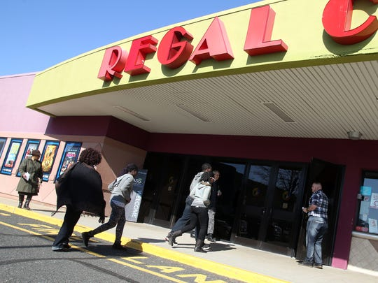 Parishioners of the Oasis Church enter Regal Cinemas, Sunday, February 28, 2016, for a church service in South Plainfield.