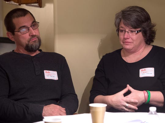 With her husband Mark looking on, Missy Sweitzer talks