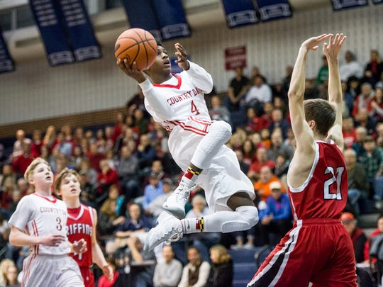 York Country Day's Raymond Hamilton (4) rises toward the basket against Sullivan County during the first round of the PIAA Class A boys' basketball tournament at Dallastown High School Friday. York Country Day won, 51-42.