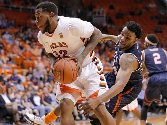 UTEP freshman Terry Winn goes up strong in the Miner's