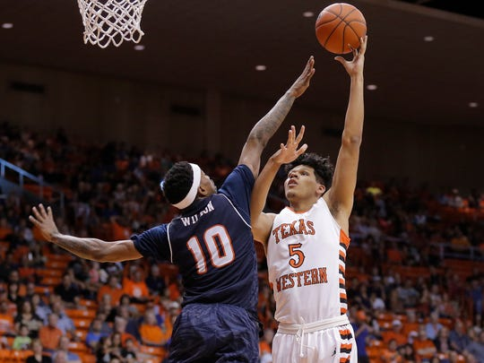 UTEP's Paul Thomas shoots over UTSA's Christian Wilson in the first half of their game Saturday at the Don Haskins Center in El Paso.