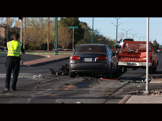El Paso police investigate an accident in which a police