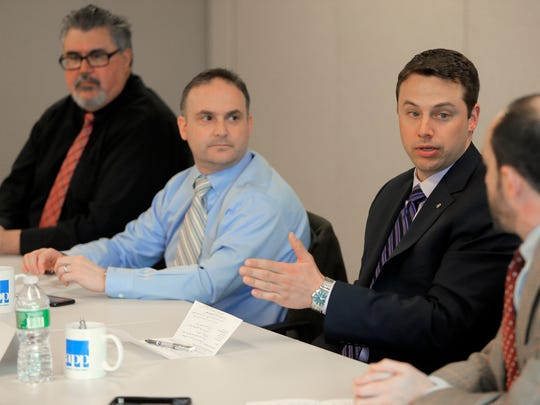 Toby Stark (right) from Stark Associates speaks during the Asbury Park Press Business Roundtable on health care affordability in Neptune. Also shown are Dr. Marc Feingold (center), a primary care physician, and Dr. James Matera from CentraState Medical Center.