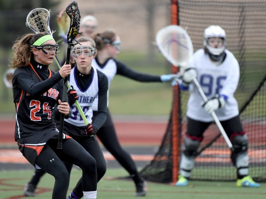 Central York's Jill Czaplinkski tries to get past the Northern High School defense during the lacrosse Play Day at Central York High School on Saturday.