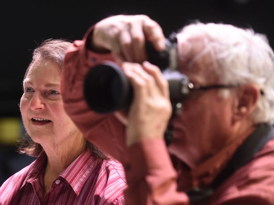 Diane Crews, the director of 'Young King Arthur,' looks on as photographer Scott Miller, takes pictures of the cast at DreamWrights Youth and Family Theatre.