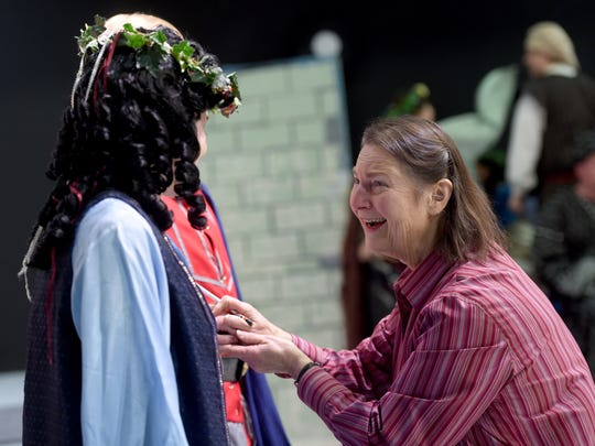 Diane Crews, the director of 'Young King Arthur,'  straightens out the costumes of actors Aimee Kallstrom and Jacob Whitacre while the duo have their photos taken at DreamWrights Youth and Family Theatre. Crews, the theater's founding member, artistic director and playwright-in-residence is retiring after directing her final production.
