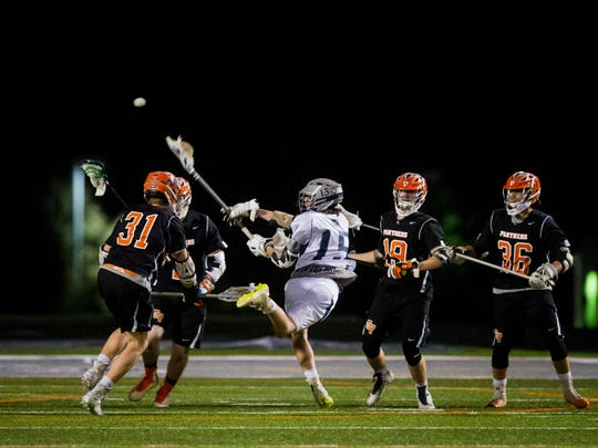 Dallastown's Ryan Dodson (15) attempts a behind-the-back shot on goal against Central York in a YAIAA boys lacrosse game at Dallastown Area High School on Friday, April 1, 2016. Central York won 13-11.