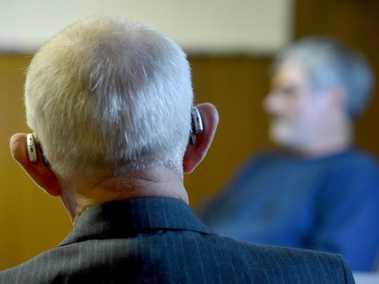 While wearing two hearing aids, veteran North Hopewell Township Police Chief Larry Bailets listens to testimony about his hearing limitations during a public hearing at the township office on Tuesday.