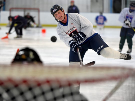 "Rich Garrison of North Codorus Township takes a shot on goal during warm-ups for the USA Warriors hockey team in Rockville, Md. on Wednesday, April 6, 2016. ""I want to get over (the war),"" said Garrison, a veteran who was disabled from tours in Iraq and Afghanistan. ""The Polar Bears and the Warriors are actually steps for me to get away,  to put that part of my history behind me. I want to put it behind me and move on."""