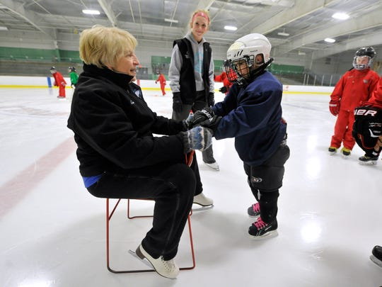 York City Ice Arena skating coach Lin Huber helps guide Myles Miller around  the ice during one of the first York Polar Bears hockey practices on Tuesday, March 15, 2016. Myles, who is autistic, is part of the team established by Rich and Vickie Garrison of North Codorus Township for special needs children.
