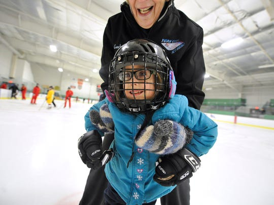 Vivienne Giblin, 5, is all smiles as York City Ice Arena skating coach Lin Huber helps her around on the ice for her first session as a member of the York Polar Bears hockey team on Monday, March 7, 2016. Vivienne, who is blind in her left eye and wears a prosthetic, was on the ice for the first time in her life as she joined the team established by Rich Garrison of North Codorus Township for disabled children.
