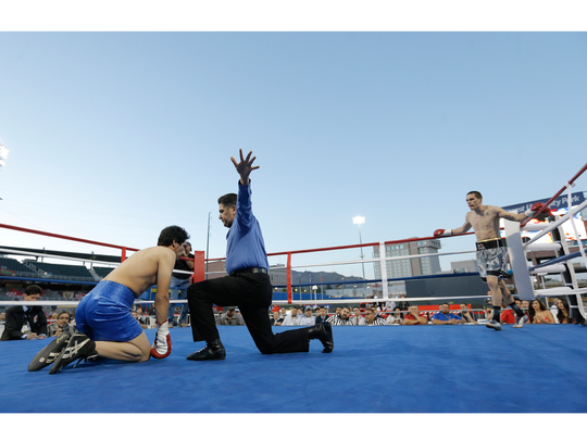 Referee Robert Velez stops the middleweight fight between Eddie Ortiz and Ivan Marruffo on Friday. Marruffo took a beating in the fight.