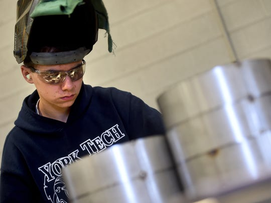 'I feel like I've set myself up for a good future.' said Daniel Harlacker, seen here preparing to weld rolled up strips of metal during his job at Herr and Sacco in Lancaster County. Harlacker, who will graduate from York County School of Technology in June, has been doing a co-op with the company this year.