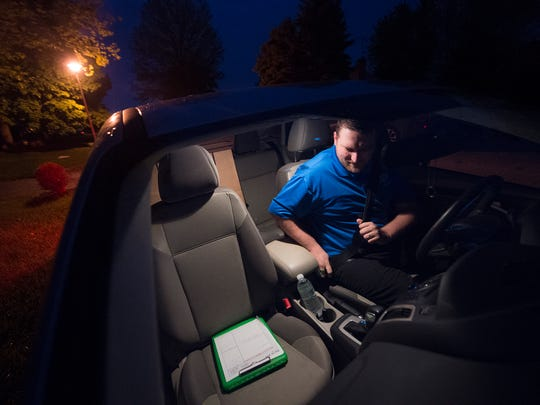 In the early morning light of his car, Charlie Cook buckles his seatbelt before leaving his Shrewsbury home to head to work in Laurel, Maryland. Cook usually leaves for work by 5:30 a.m. He is among a number of Shrewsbury residents who have long commutes.