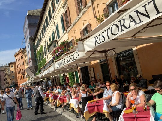 Dining al fresco on Piazza Navona in Rome, Italy.