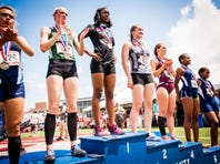 South Western's Lynne Mooradian, center, stands on the podium after taking second place in the AAA girls 300 hurdles during the PIAA Track and Field Championship meet at Shippensburg University on Saturday, May 28, 2016.