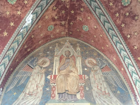 This painting of Jesus on a throne, flanked by angels, is one of the surviving works at the Woods Cathedral, an abandoned Detroit church that's being turned into an art gallery.