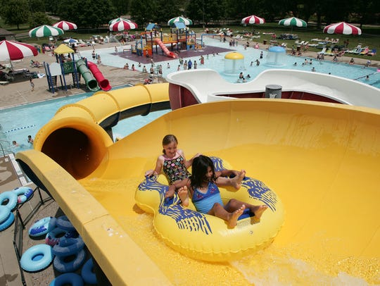 Children tube down a slide Tuesday afternoon at Coshocton's