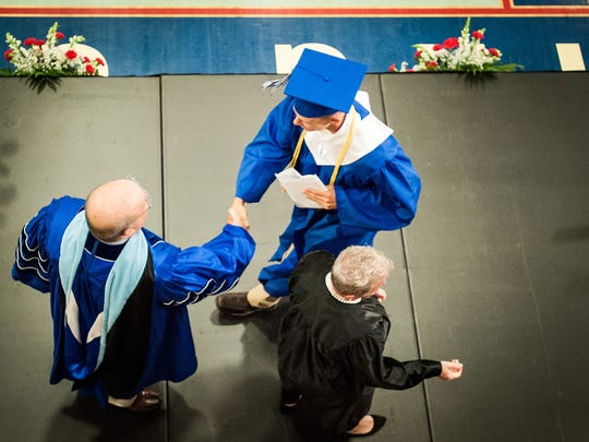 Spring Grove Area High School senior Matt Brooks shakes