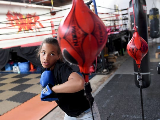 Adriana Dorm trains in her father's gym, Stick-N-Move.