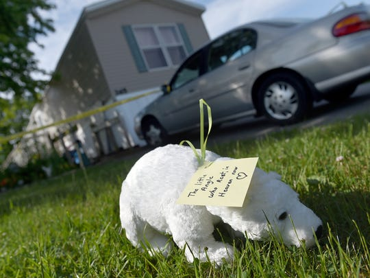 Barb Sipe left a stuffed polar bear and note on the front lawn of  her neighbor's home, where a 3-year-old girl was found dead in her Jackson Township home Wednesday night.
