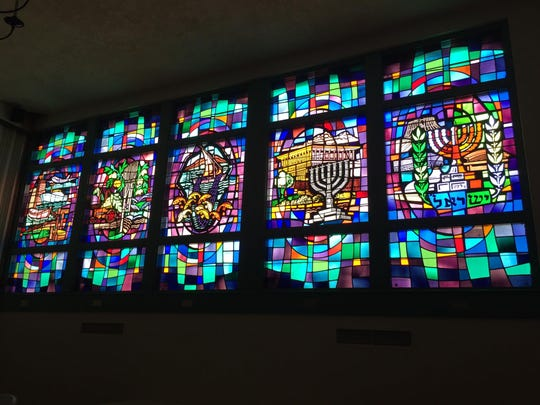 The sun shines through the stained glass in Beth Israel's