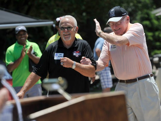 "Former NFL players Maxie Baughan, right, and Bill Bradley joke as they're introduced to their teams Monday before the 28th annual Eddie Khayat-George Tarasovic Celebrity Golf Classic at the Out Door Country Club. ""That's the thing about football: You hit a guy once and you're best friends for life,"" Baughan joked before the fundraiser for the York County Special Olympics."