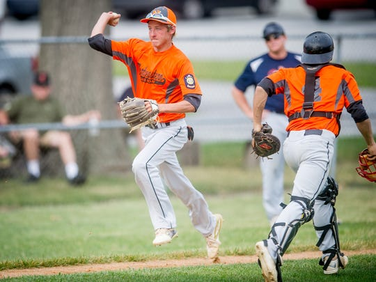 Northeastern's Kenny Kopp (3) chases down Spring Grove's Logan Miller (16) in a rundown between third base and home plate in an American Legion baseball game in Manchester on Monday. Northeastern won, 1-0.