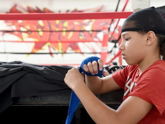 Antwoine Dorm Jr. wraps his hands before training at
