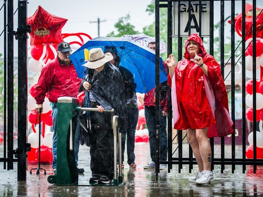 Fans arrive in the rain at the main gates of Clipper Magazine Stadium in Lancaster for the Atlantic League All-Star Game on on Wednesday, July 13, 2016.