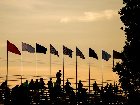 The sun sets Friday over the grandstands at Williams Grove Speedway.