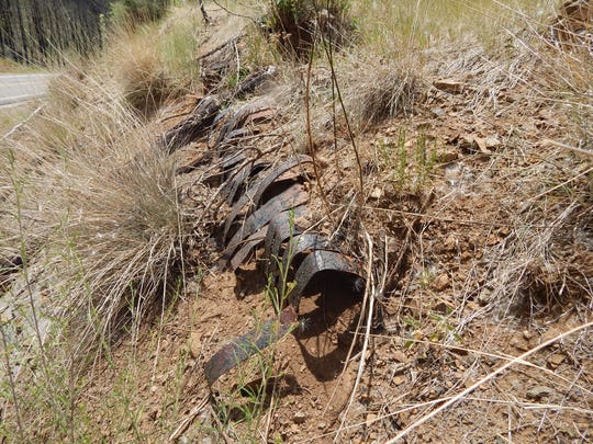 Before the Little Bear fire, the wooden slats of the original pipeline could be seen jutting out of the roadside banks just north of the Bonito Lake turnoff on Highway 37. Now just the rusted flat metal bands can be seen, crumpled and resembling the rib cage of a long, round creature making its way to a dry Nogal Lake.