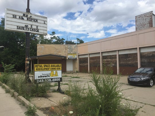 This former muffler shop would be torn down to make