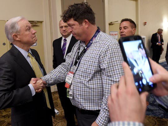 Matthew Jansen, right, a Pennsylvania delegate representing the 4th Congressional District, has his photo taken while having a quick conversation with U.S. Sen. Jeff Sessions of Alabama after the Pennsylvania Republican delegate breakfast in the Westlake, Ohio DoubleTree by Hilton Hotel on Tuesday, July 19, 2016.