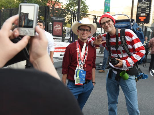 """""""I noticed how many people just really smiled and took photos and gave me hugs. It was really nice,"""" said Justin Vetter of Pittsburgh, right, dressed like Waldo while posing for photos . Vetter dressed like the children's book character while walking around Cleveland and meeting with people outside of the Republican National Convention held the Quicken Loans Arena on Tuesday, July 19, 2016."""