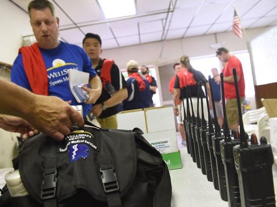 Members of the medical staff collect bags and walkie-talkies in the first aid building at the York Expo Center to prepare for their role in the Keystone State Games.