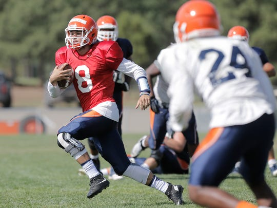 UTEP quarterback Zack Greenlee takes off after not finding an open receiver during the team's scrimmage Tuesday at Camp Ruidoso.