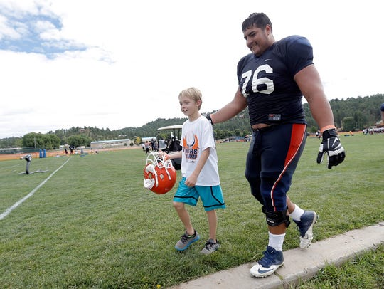 Will Hernandez, a UTEP offensive lineman, walks with