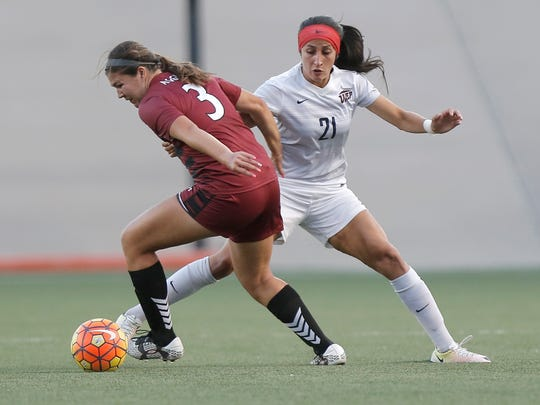 UTEP midfielder Bri Barreiro defends NMSU's Audrey Chavez during their season opener Friday at University Field.
