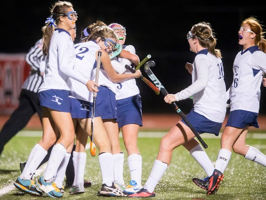 Dallastown players swarm around Molly Lohss (2) after
