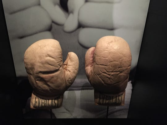 Boxing gloves belonging to Detroit boxing phenom Joe Louis, on display at the new National Museum of African American History and Culture in Washington D.C., press preview day on Wednesday Sept. 14. The museum opens to the publkic on Sept. 24.