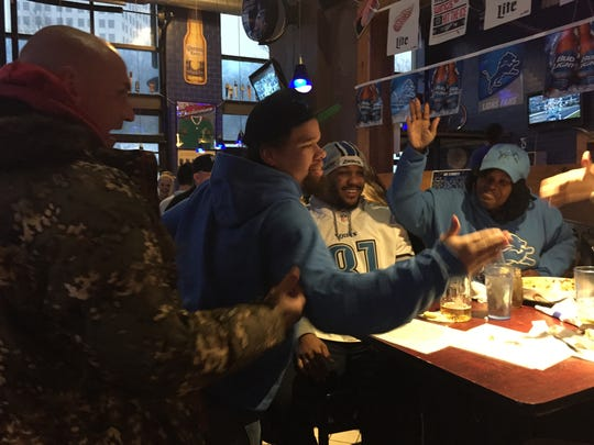 Fans celebrate at R.U.B. BBQ Pub in downtown Detroit after the Lions score first touchdown Sunday Jan. 4.(From left to right John Revel, 56, Robert Kyme, 26, Dominic Charles, 24, and Sarah Howard, 43, all from Detroit.