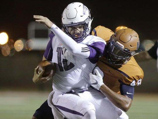 Eastlake quarterback Keith Tarango Lopez is hit by