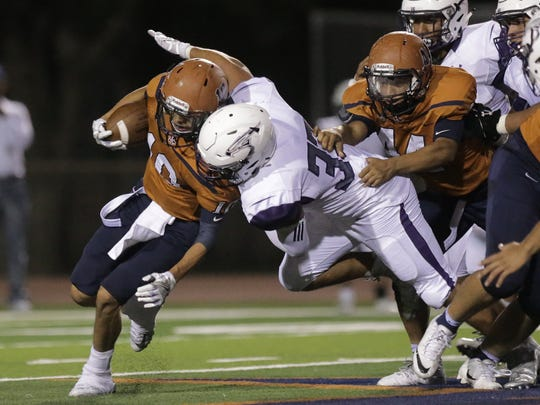 Eastlake linebacker Chris Sepulveda sacks Riverside quarterback Jonah Vargas in the second half of their game last season at Riverside High School.