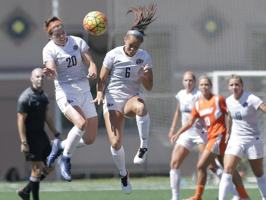 UTEP's Jeanna Mullen wins a header against teammate