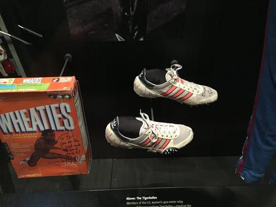 Track shoes worn by Jackie Joyner Kersee and her Wheaties Box, on display at the new National Museum of African American History and Culture in Washington D.C., press preview day on Wednesday Sept. 14. The museum opens to the publkic on Sept. 24.